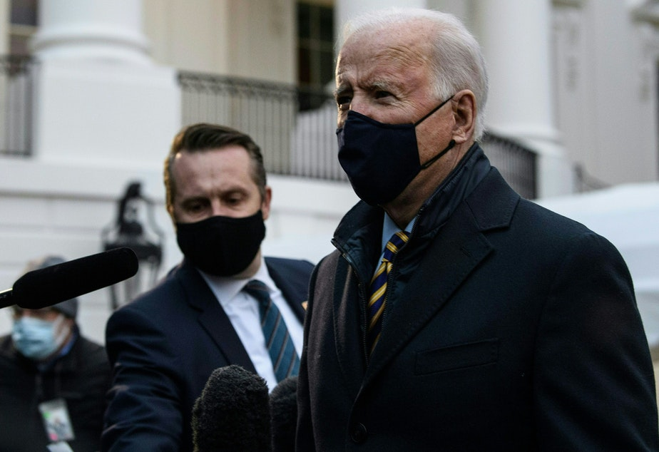 caption: President Biden speaks to the press before departing the White House for Milwaukee, Wis. on Feb. 16.