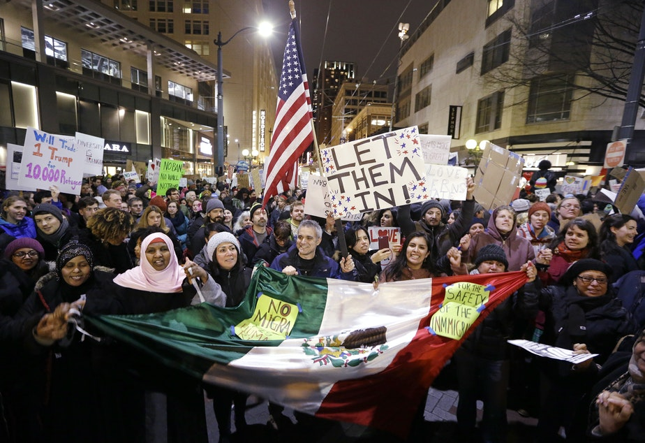 People cheer during a rally to oppose President Donald Trump's executive order barring people from certain Muslim nations from entering the United States, Sunday, Jan. 29, 2017, in downtown Seattle.