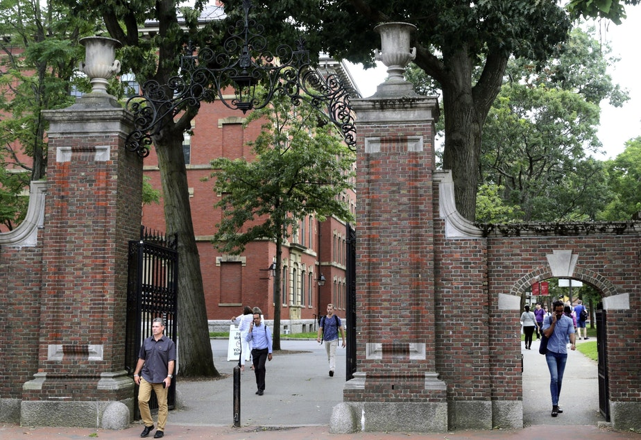 caption: Pedestrians in Harvard Yard in 2019. Schools and businesses have gone to court to stop the Trump administration from barring online-only international students from entering or staying in the United States.