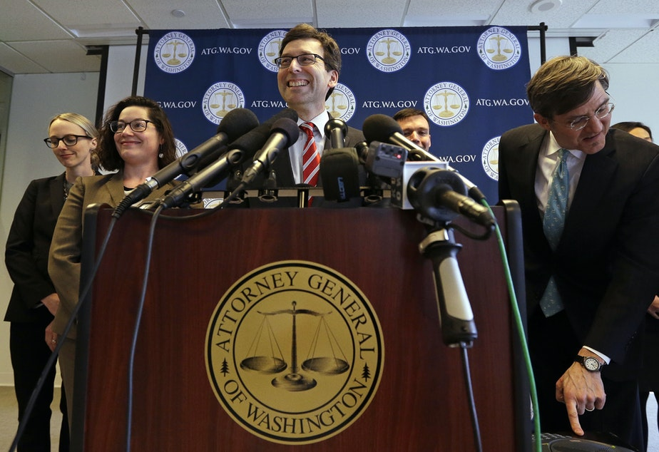 Washington state Attorney General Bob Ferguson smiles during a news conference about President Trump's new executive order Monday, March 6, 2017, in Seattle.