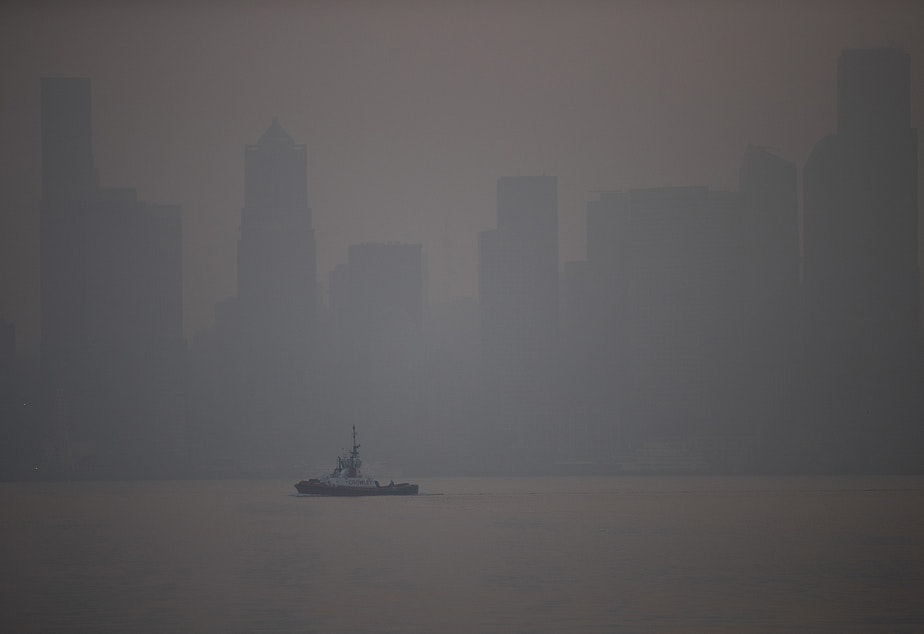 caption: The sun comes up over Seattle as a massive plume of smoke from wildfires burning in California and Oregon made it's way into the area, on Friday, September 11, 2020, in Seattle.