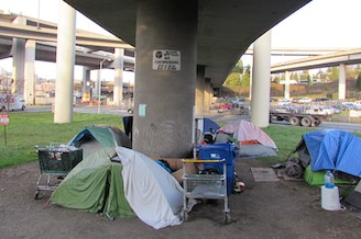 A homeless camp beneath an Interstate 5 off-ramp in Seattle's SODO district.