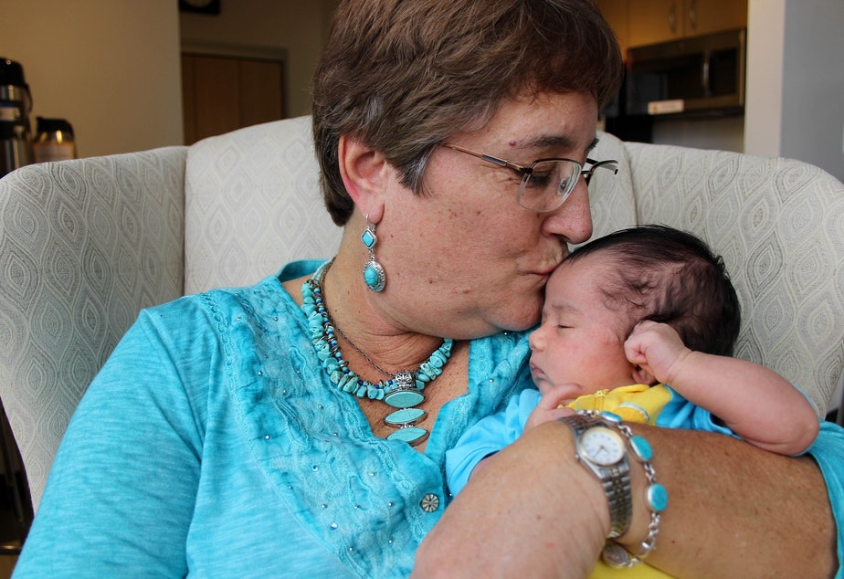Cindy McIntyre kisses her 1-month-old granddaughter Sophie Lin. She wrote Sophie Lin a letter, telling her that in the 1960s and 70s, they wondered if they should bring kids into the world. And yet out of that era came good, she says.