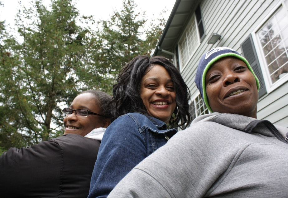 caption: Michelle Dozier, Toya Thomas and Elimika James faced eviction from the Renton Woods apartments, so they fought to bring renters' rights to Renton.