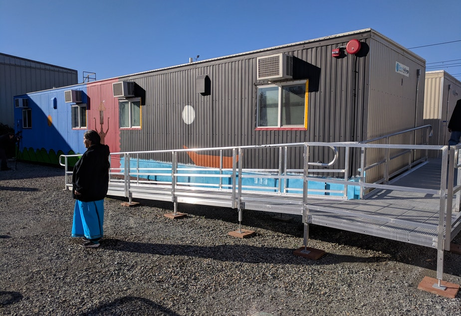 caption: Eagle Village offers temporary housing in modular units for Native people experiencing homelessness