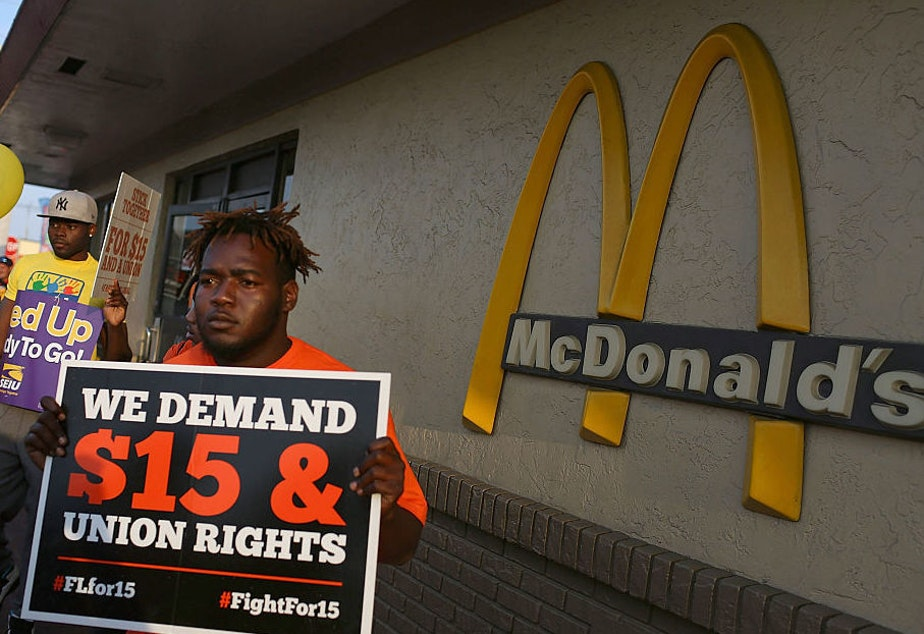 Demonstrators gather together at a McDonalds restaurant as they demand an increase in the minimum wage to $15 an hour on April 14, 2016 in Miami, Florida.