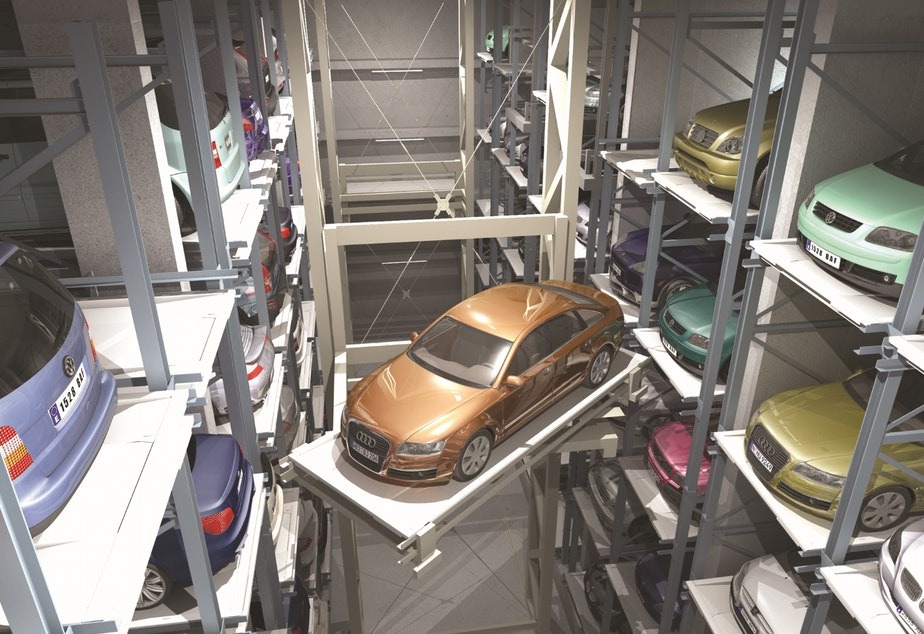 Someday, parking garages may be obsolete. Meanwhile, here come the robots.