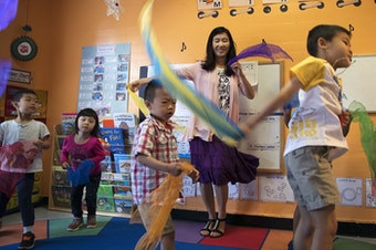 Seattle Preschool Program teacher Hien Do dances with her students on June 28, 2017, at the ReWA Beacon Hill Early Learning Center in Seattle.