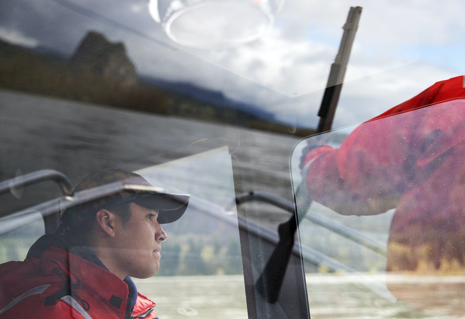 Devayne Lewis, a fishery technician with the Columbia River Inter-Tribal Fish Commission operates the boat while Teddy Walsey, right, looks for sea lions during a non-lethal hazing mission where shell crackers and sticks of dynamite are used to scare sea lions away from the area on Friday, April 12, 2019, near the Bonneville Dam.
