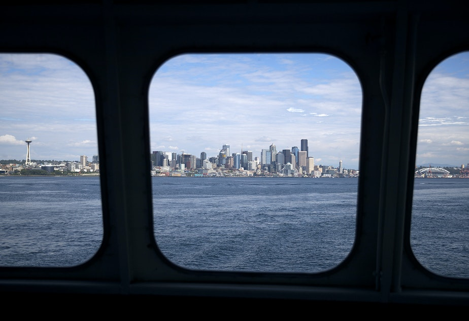 caption: A view of Seattle is shown from the Bremerton ferry on  Wednesday, May 22, 2019. Tanya van Cuylenborg and Jay Cook, of Victoria, B.C., may have taken this ferry with their Ford van in November 1987, the night that they disappeared.