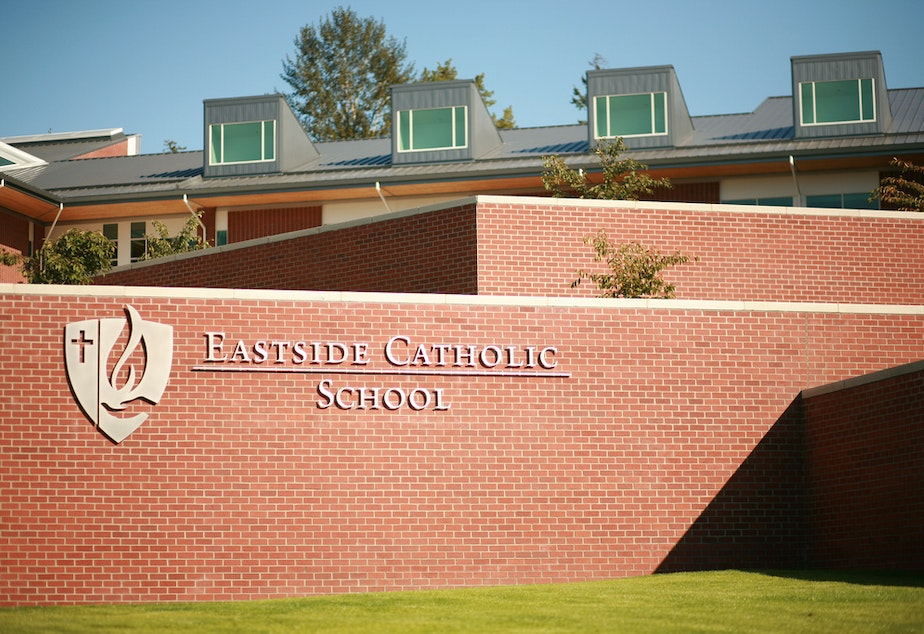 caption: Students at Eastside Catholic High School held a sit-in on Thursday in solidarity for the vice principal who was asked to resign.