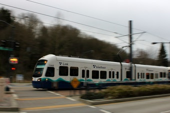 A Sound Transit light rail train nears Othello station in Seattle.