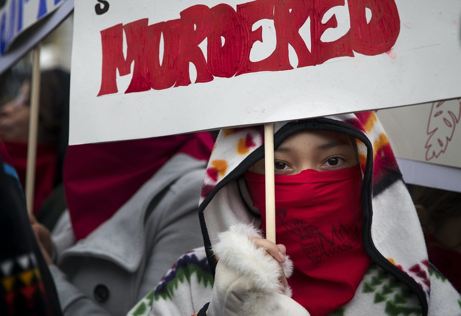 caption: Denae Shippentower, 11, of the Puyallup Tribe stands with other members of the Missing and Murdered Indigenous Women of Washington group before the start of the Women's March on Saturday, January 20, 2018, in Seattle.
