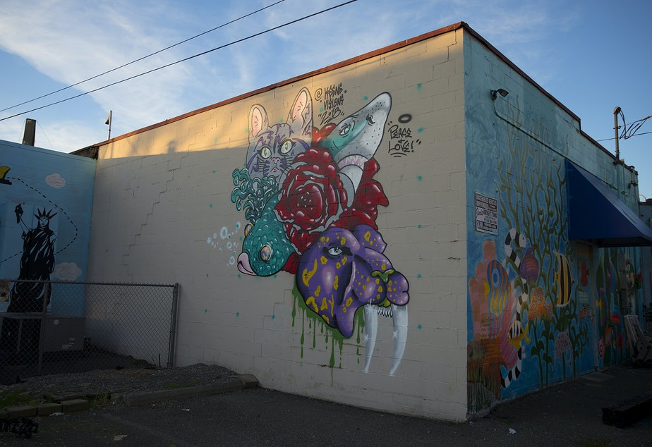 Murals are on display on the back The Fish Store on Thursday, December 6, 2018, along Lake City Way Northeast in Seattle.