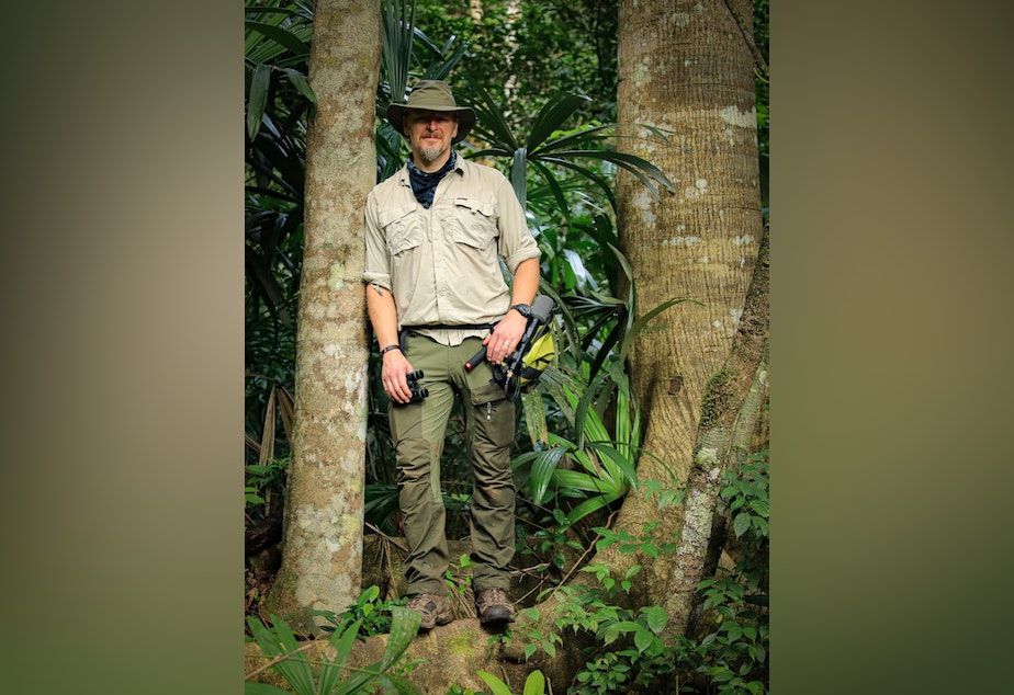 caption: Host of THE WILD Chris Morgan is ready with is microphone to record an episode in Belize. December 2020.