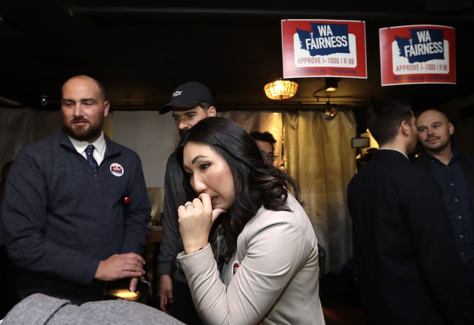 Hyeok Kim, left, a chair for WA Fairness, watches for early results at an election night party for supporters of Referendum 88, Tuesday, Nov. 5, 2019, in Seattle. Voters were deciding whether one's minority status should be considered as a contributing factor in state employment, contracting and admission to public colleges and universities.