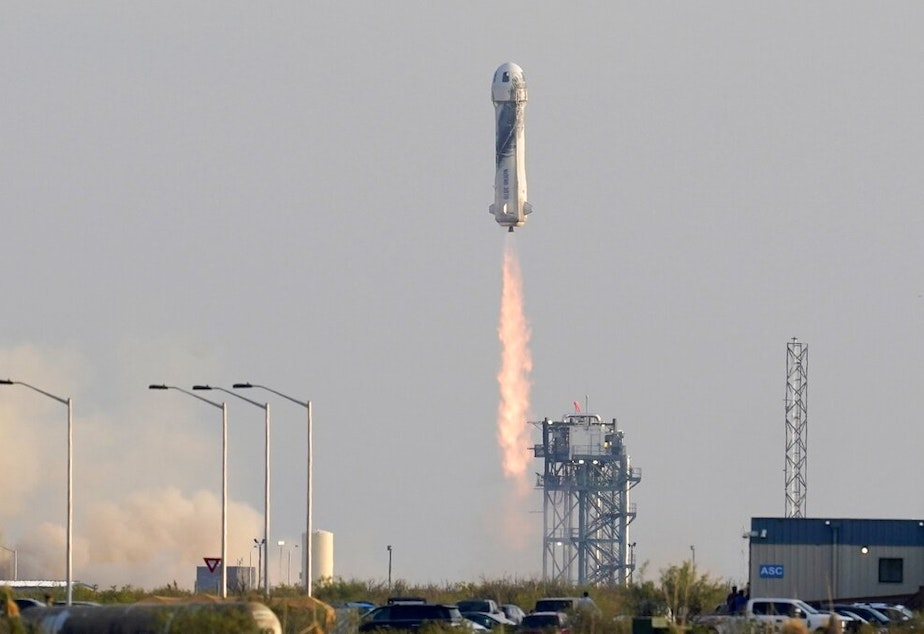 caption: Blue Origin's New Shepard rocket launches carrying passengers Jeff Bezos, founder of Amazon and space tourism company Blue Origin, brother Mark Bezos, Oliver Daemen and Wally Funk, from its spaceport near Van Horn, Texas, Tuesday, July 20, 2021.