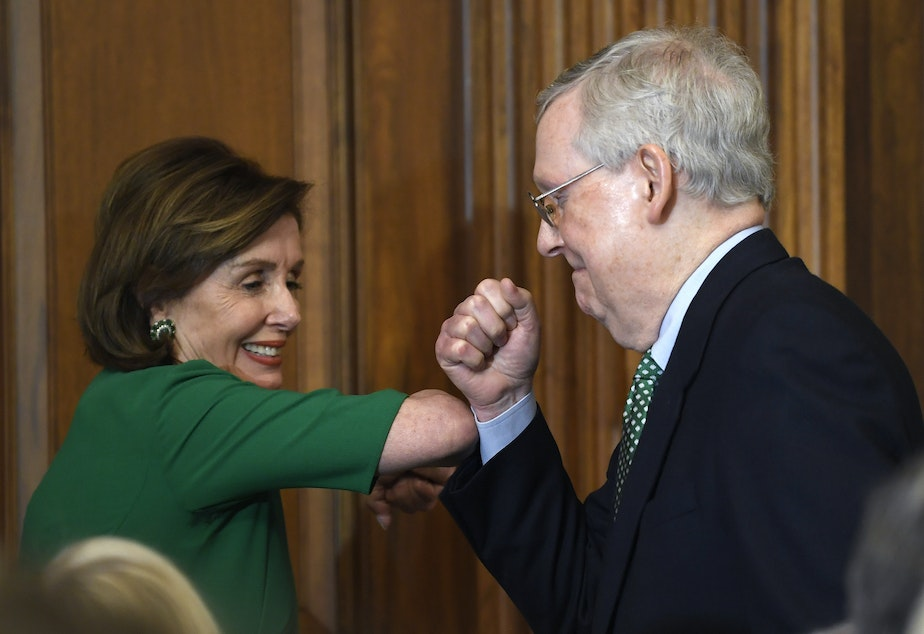 caption: House Speaker Nancy Pelosi and Senate Majority Leader Mitch McConnell bump elbows on Capitol Hill on March 12, 2020.