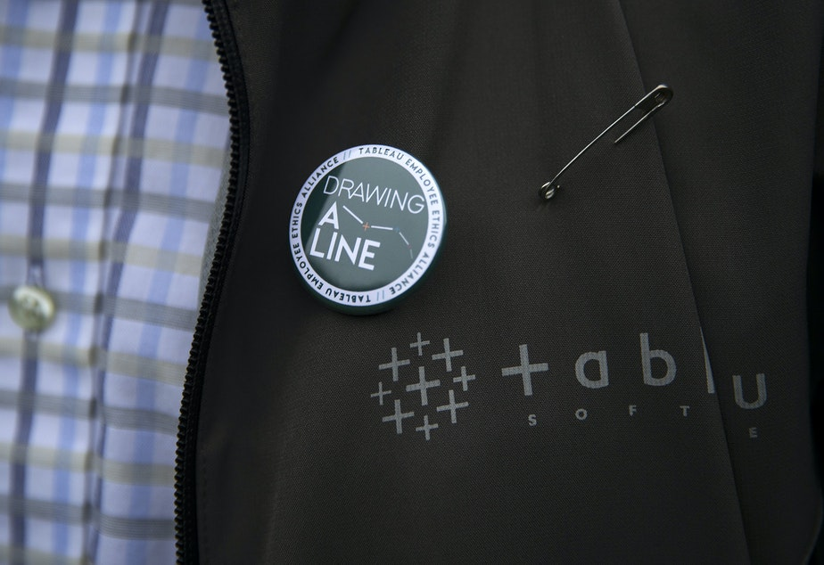 James Baker wears a 'Drawing A Line' pin on Wednesday, December 4, 2019, in Seattle.