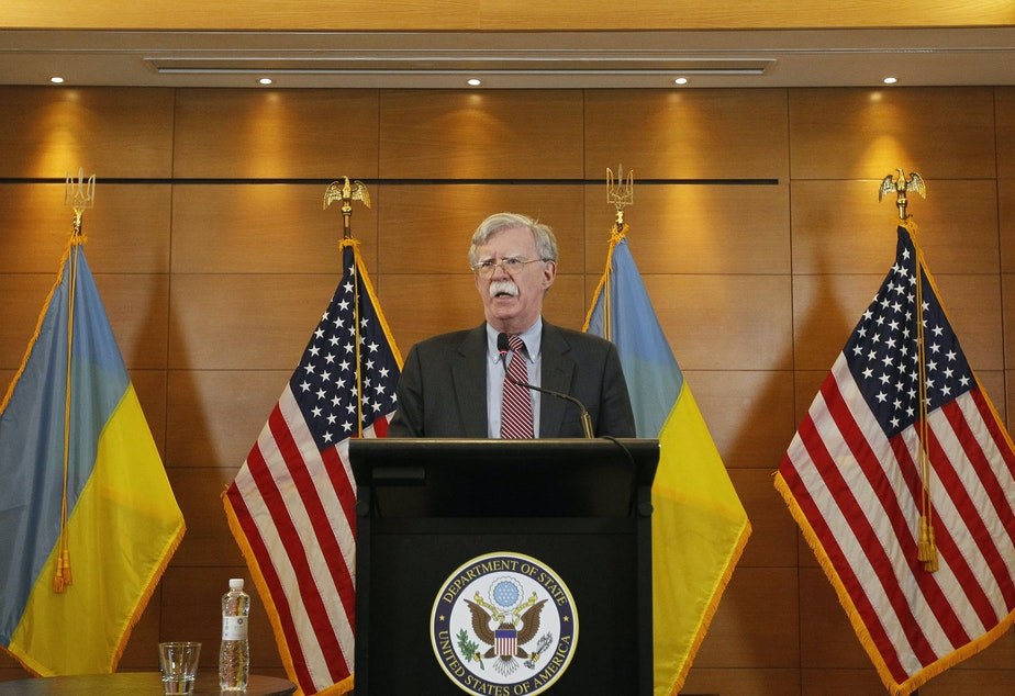 caption: Then-national security adviser John Bolton speaks during a media conference in the Ukrainian capital of Kyiv on Aug. 28, 2018. Bolton, a lifelong Russia hawk, has been described as objecting to Trump's Ukraine policy: Holding up military assistance intended to help Ukraine resist Russian military activity was antithetical to Bolton's worldview.
