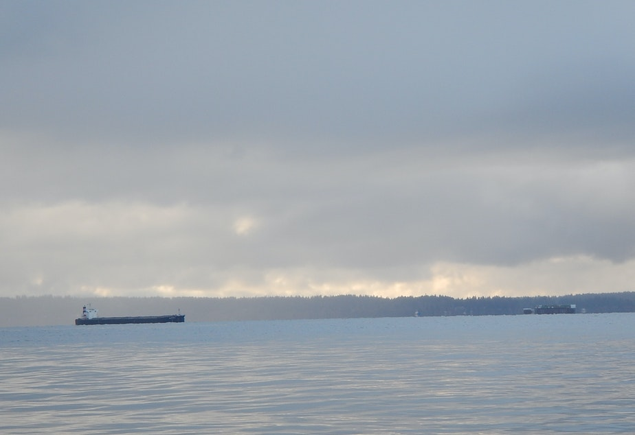 caption: An oil tanker and a container ship about to cross paths near Seattle.