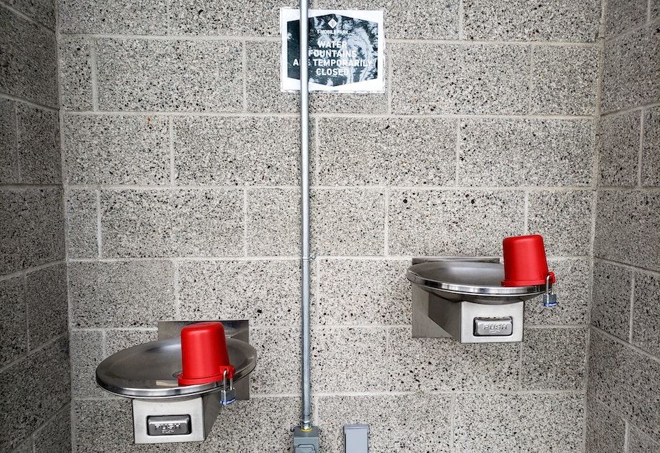 caption: Padlocked drinking fountains are one of the ways T-Mobile Park is trying to slow the spread of the coronaviurs. Thursday, April 1, 2020