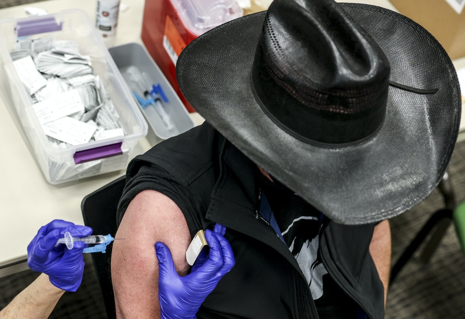 caption: Colorado's UCHealth hospital system is requiring any prospective organ transplant recipients to get the COVID-19 vaccine. Here, a man receives a COVID-19 vaccine in Thornton, Colo., earlier this year.