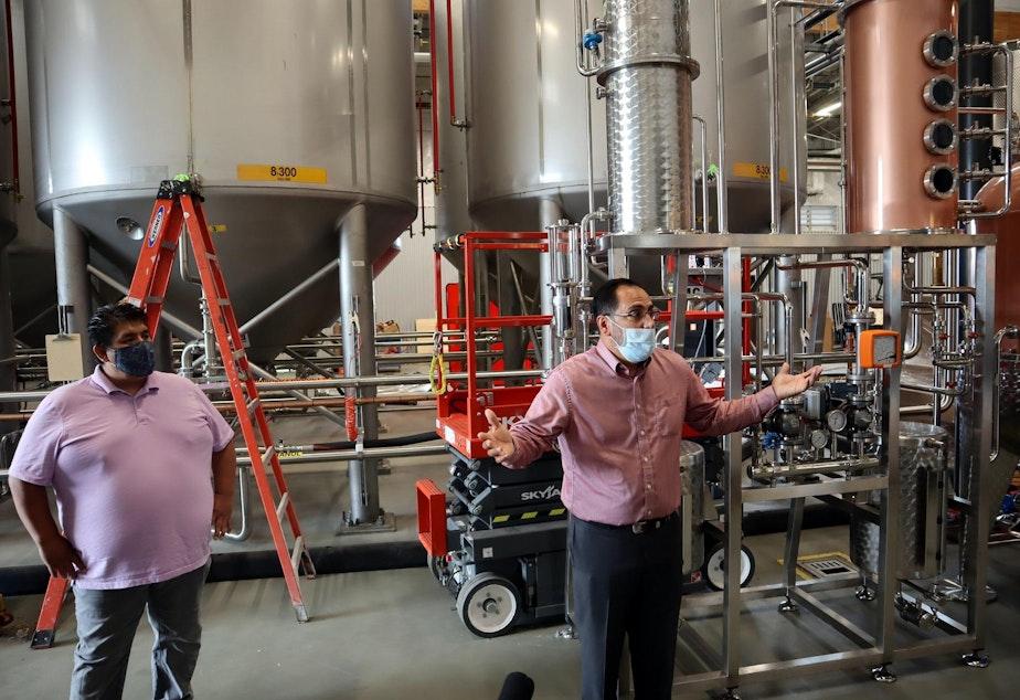 caption: Chehalis tribal chairman Harry Pickernell, left, looks on as Chehalis Tribal Enterprises CEO David Burnett explained distillery operations during a tour Thursday.