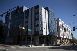 The newly constructed Arbora Court Apartments, with 133 units, is shown on Monday, April 23, 2018, in Seattle. Forty of the apartments have been set aside for families transitioning out of homelessness.