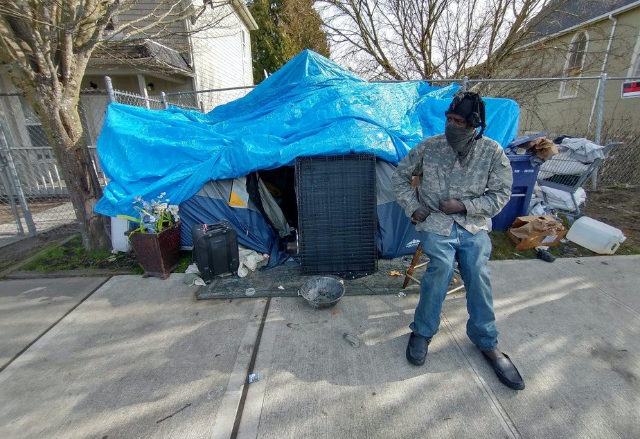 caption: Tony Nelson outside his tent on MLK in Tacoma's Hilltop neighborhood.