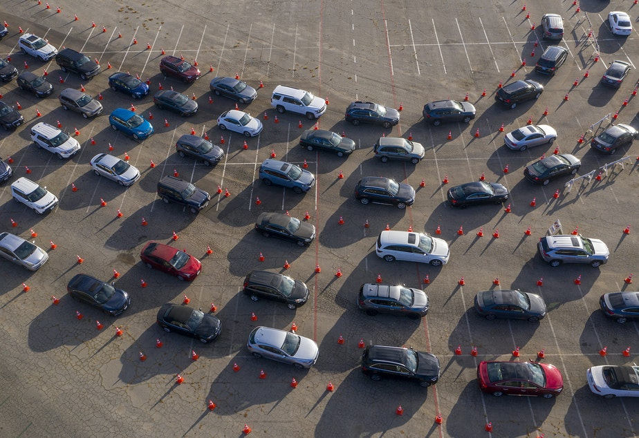 caption: In an aerial view from a drone, cars line up at Dodger Stadium for COVID-19 testing in Los Angeles, California.