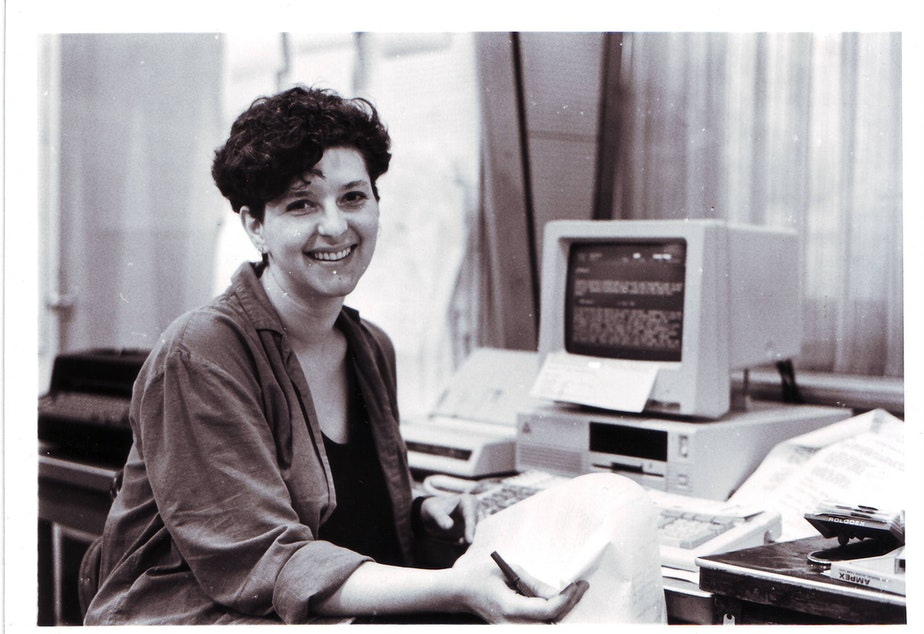 caption: Marcie Sillman preparing for 'All Things Considered.' She was KUOW's local host from 1987 to 1992.