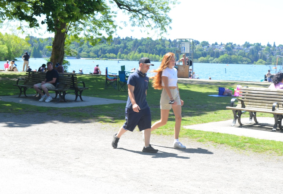caption: In mid-May, almost everyone walking around Seattle's Green Lake was maskless.