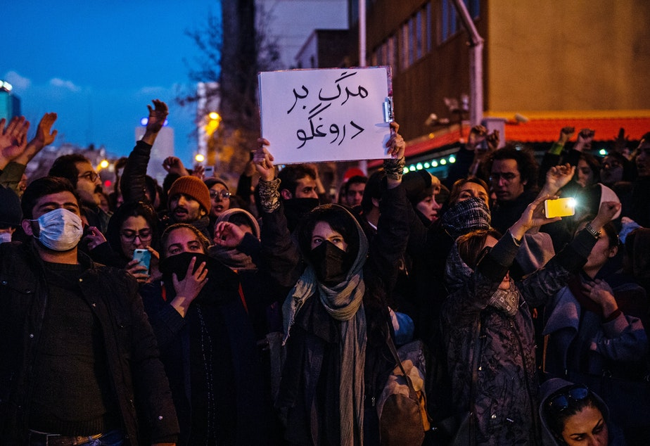 caption: Mourners chant while gathering in Tehran over the weekend for a vigil for victims of Iran's unintentional downing of a Ukrainian airliner. As protests continue, Iran says it has made several arrests in the catastrophe.