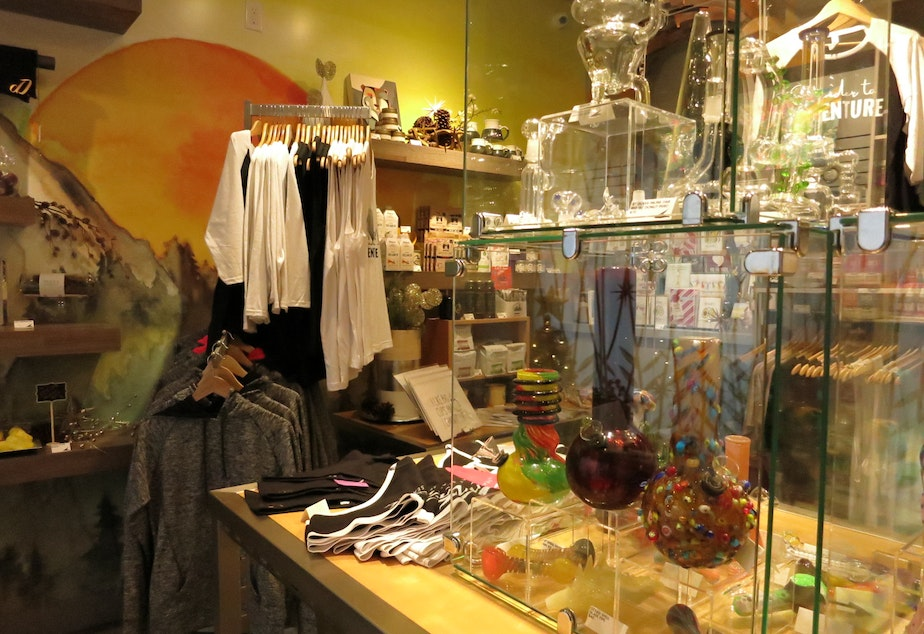 A glass case holds bongs, pipes, and other marijuana paraphernalia at the Canna West Culture Shop in West Seattle.