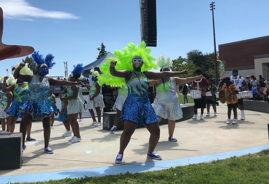 caption: At Umoja Fest, the Washington Diamonds drill team and drum line savored what may be their only performance this summer.