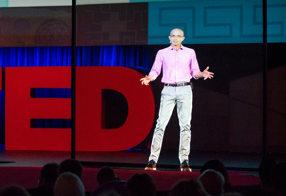 caption: Yuval Noah Harari on the TED stage.