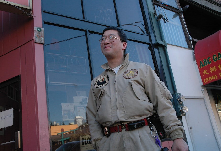 caption: A photo of Donnie Chin from The Wing Luke Museum archives. Chin was a cherished safety steward of the neighborhood.