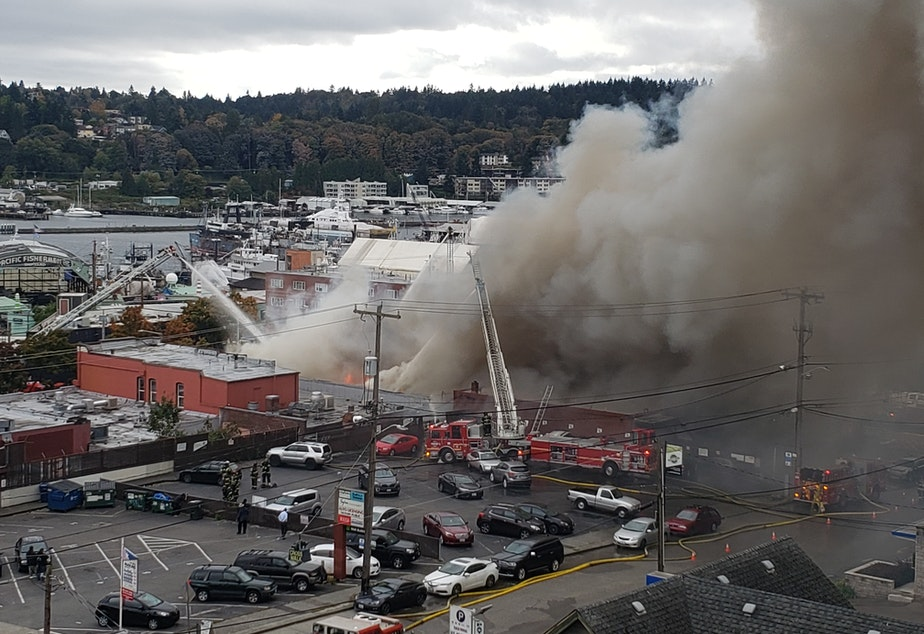 caption: A fire rages in Ballard, at 23rd Avenue Northwest and Market in Seattle.