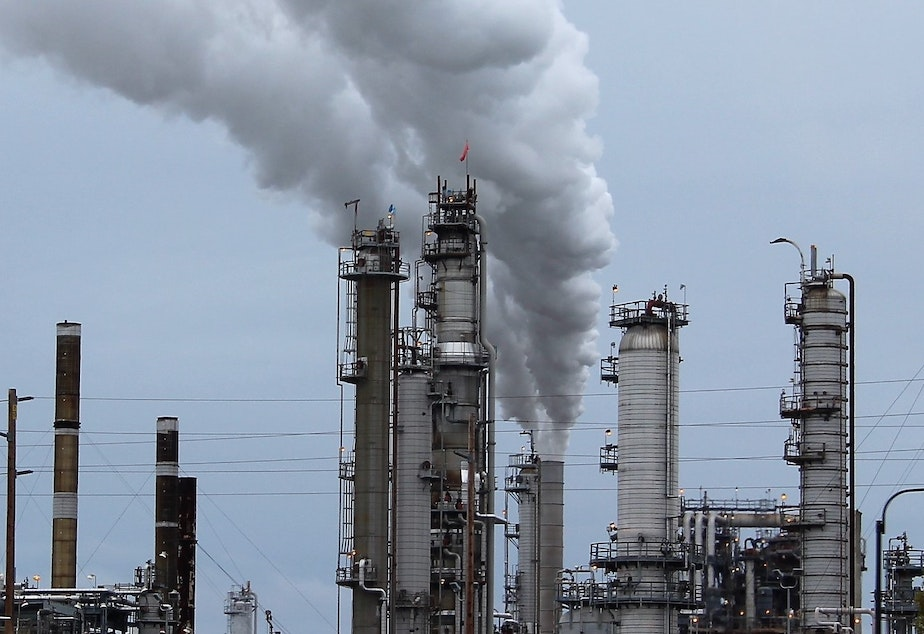 caption: Steam and invisible, heat-trapping carbon dioxide spew from a Shell oil refinery in Anacortes, Washington