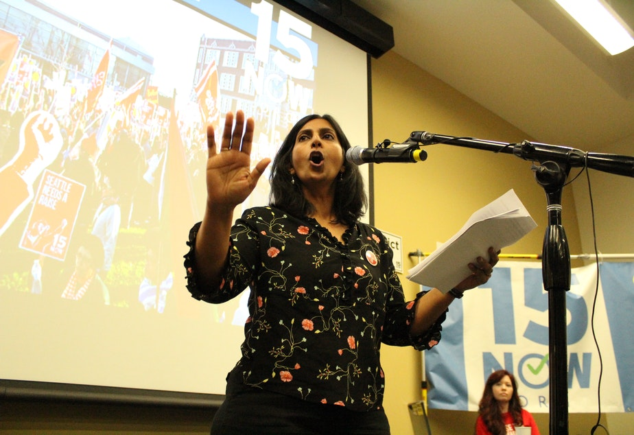 caption: Socialist City Council Member Kshama Sawant speaks at a recent rally for the 15 Now group.