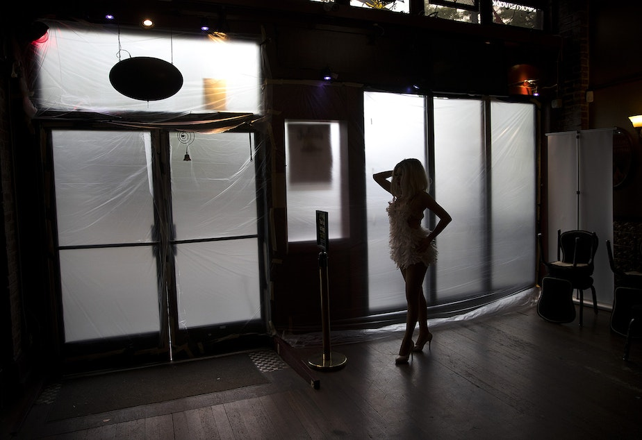 caption: Drea rehearses while looking into a mirror before a live-streamed Le Faux happy hour show next to covered windows on Wednesday, May 20, 2020, at Julia's on Broadway in Seattle.