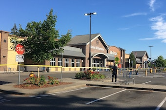 Police block the scene outside a Walmart in Tumwater where a gunman shot a driver, then was himself shot to death on Sunday afternoon.