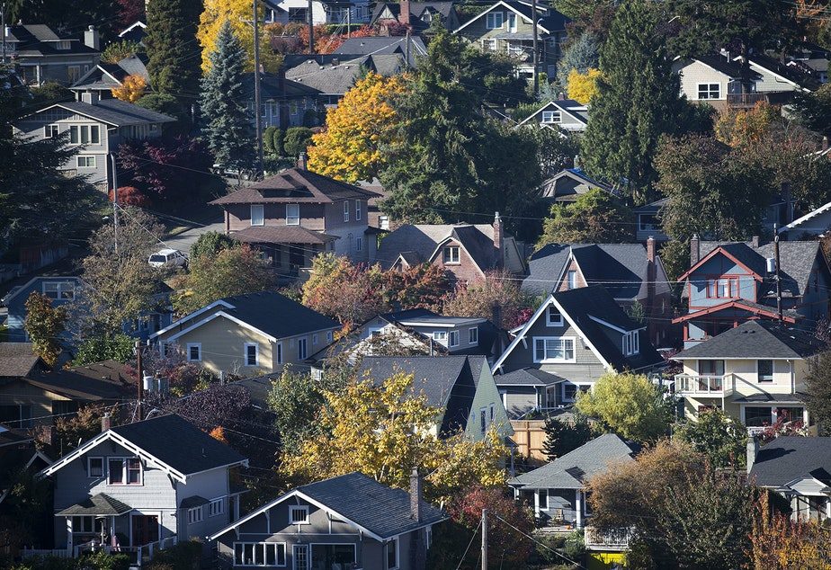 caption: Homes in Queen Anne are shown from the Aurora Bridge on Friday, October 27, 2017, in Seattle.
