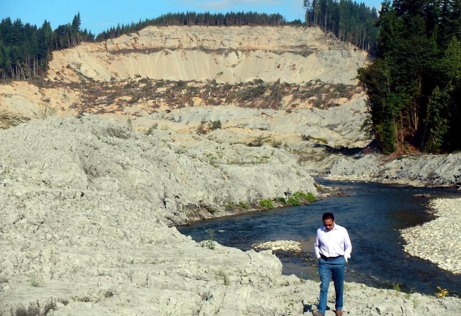 caption: SR 530 Landslide Commissioner Paul Chiles of Seattle at the Oso landslide site in August.