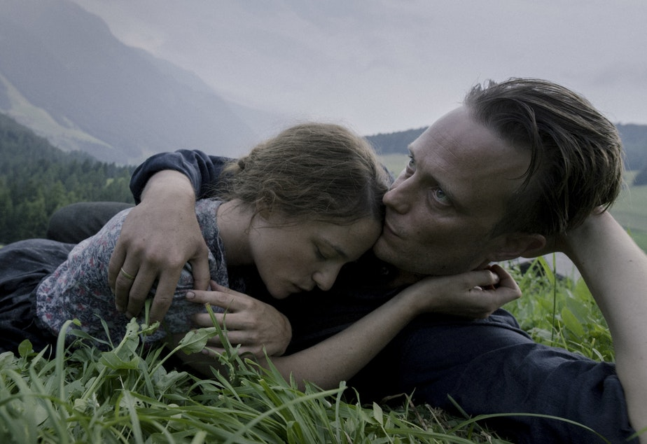 caption: Valerie Pachner and August Diehl star as Fani and Franz Jagerstatter in the film <em>A Hidden Life</em>.