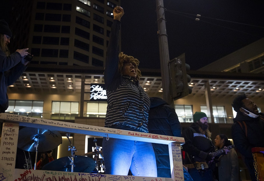 caption: Vonn Wright, also known as Fairy Vonn Mother, cheers as  Marshall Law Band plays a song from their new album, 12th and Pine, for the crowd on Monday, October 26, 2020, during the 150th day of protests for racial justice in Seattle at Westlake Park. The album was inspired by Seattle's ongoing protests for racial justice.