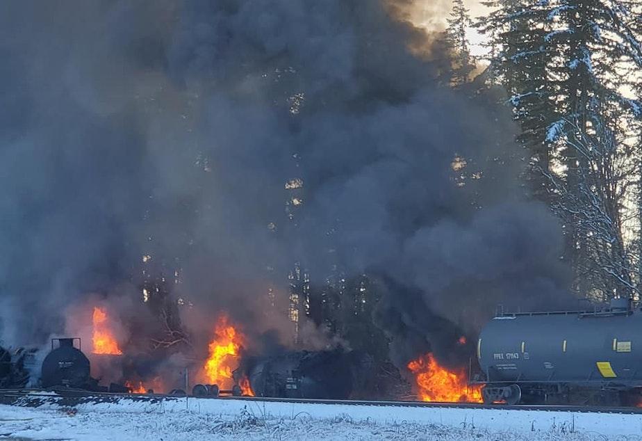 caption: Railcars carrying crude oil burn in Custer, Washington, on Dec. 22