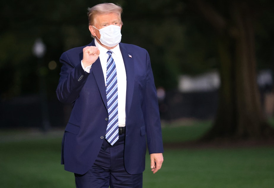 caption: President Trump returns to the White House on Monday from Walter Reed National Military Medical Center.