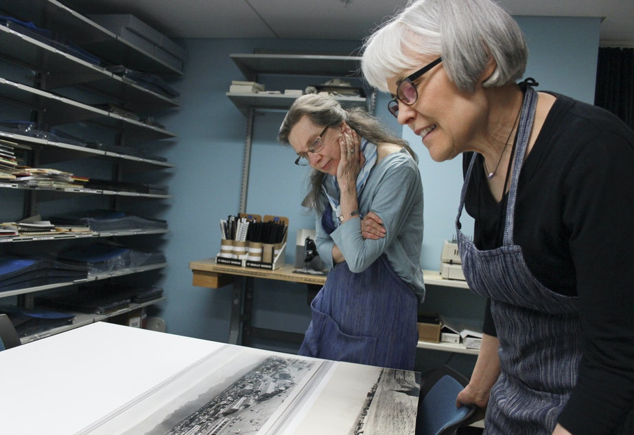 caption: University of Washington conservators Kate Leonard, left, and Judith Johnson in the UW's Conservation Center at Suzzallo Library. Conservators repair and protect 10,000 rare books, manuscripts, maps and other paper items every year.